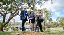 John James Foundation chair Professor Paul Smith, Minister for Disability Suzanne Orr and AEIOU Foundation chair Susan Rix turn the first sod of the new AEIOU autism hub in Canberra on Wednesday. Picture: Elesa Kurtz