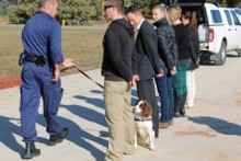 prisoners being sniffed by sniffer dog on lead
