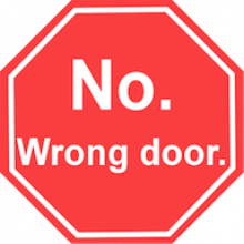 """like a stop sign but says """"No. Wrong door."""""""